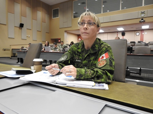 Canadian Army Chief Warrant Officer Crystal Harris takes notes on integrating gender into military operations during the Operational Gender Advisor Course hosted by U.S. Southern Command in Doral, Florida, Dec. 6, 2018.