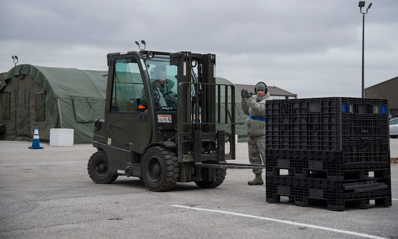 Airmen from the 375th Logistics Readiness Squadron load a forklift with a pallet of supplies at Scott AFB, Ill. Dec. 3, 2018. Phase I of the MOBEX is making sure that Airmen have all the necessary supplies to deploy.