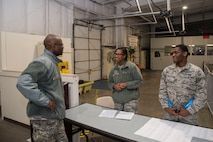 Chief Master Sgt. Leon Calloway, 375th Air Mobility Wing command chief, speaks to Airman 1st Class Lastiwa Hall 375th Force Support Squadron customer support tecnician and Staff Sgt. Shenisha Dunn, 375th Force Support Squadron during the mobility exercise at Scott AFB, Ill. Dec. 3, 2018. During the exercise Calloway visited with multiple Airmen around Scott to see the different missions involved in the exercise.