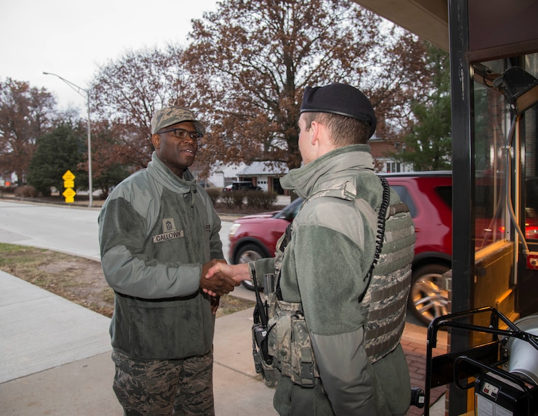 Chief Master Sgt. Leon Calloway, 375th Air Mobility Wing command chief shakes hands with Airman 1st Class John Fields, 375th Security Forces Squadron during a post check, Dec. 3, 2018 at Scott AFB, Ill. Dec. 3, 2018. During the Mobility Exercise Calloway visited with members of the 375th SFS to thank them for the work they do around the base.