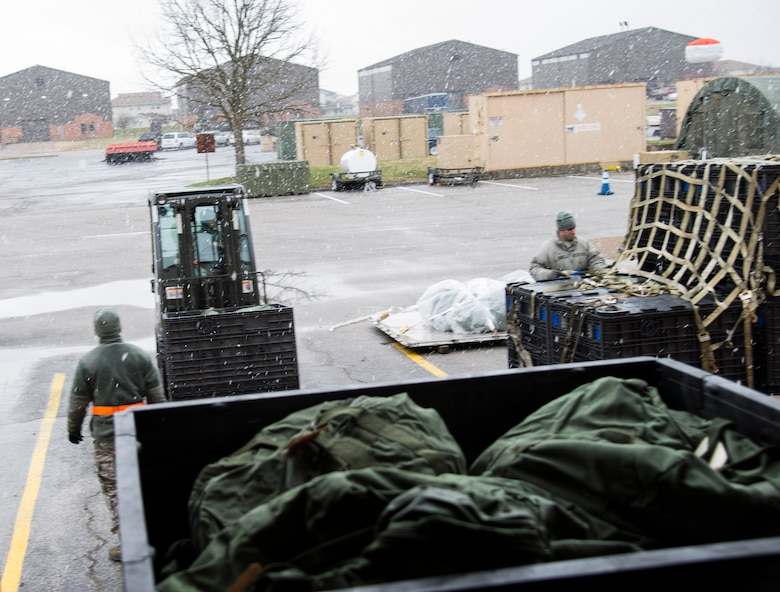 Members of the 375th Logistics Readiness Squadron unload pallets of issued equipment during a mobility exercise, Dec. 4, 2018, at Scott Air Force Base, Illinois. During the first phase of the MOBEX, Airmen are given the necessary equipment to deploy.
