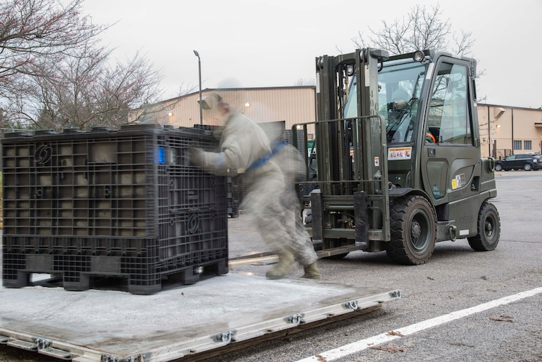 Staff Sgt. Christopher Britt, 375th Logistic Readiness Squadron data records custodian, and Airman 1st Class Eliezer Rivera, 375th LRS ground transportation, move a pallet full of equipment during a mobility exercise, Dec. 4, 2018, at Scott Air Force Base, Illinois. During the exercise, the 375th LRS makes sure that Airmen are issued all the necessary equipment to deploy.
