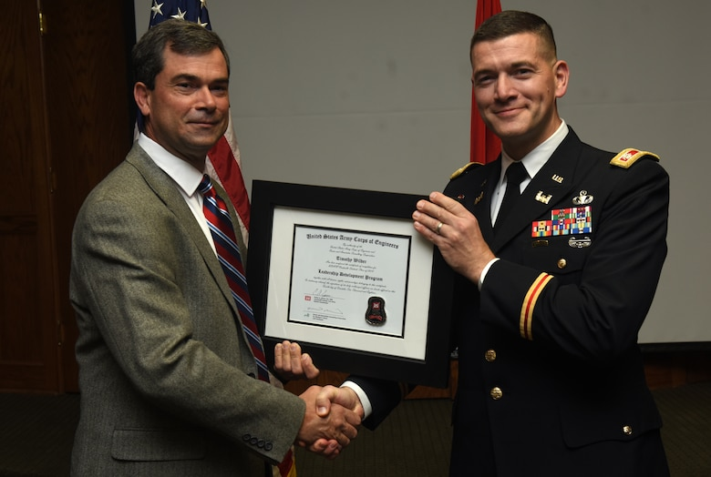 Lt. Col. Cullen Jones, U.S. Army Corps of Engineers Nashville District commander, presents a graduation diploma for the 2018 Leadership Development Program Level II Course to Tim Wilder during a graduation ceremony Dec. 4, 2018 at the Scarritt Bennett Center in Nashville, Tenn. (USACE Photo by Lee Roberts)