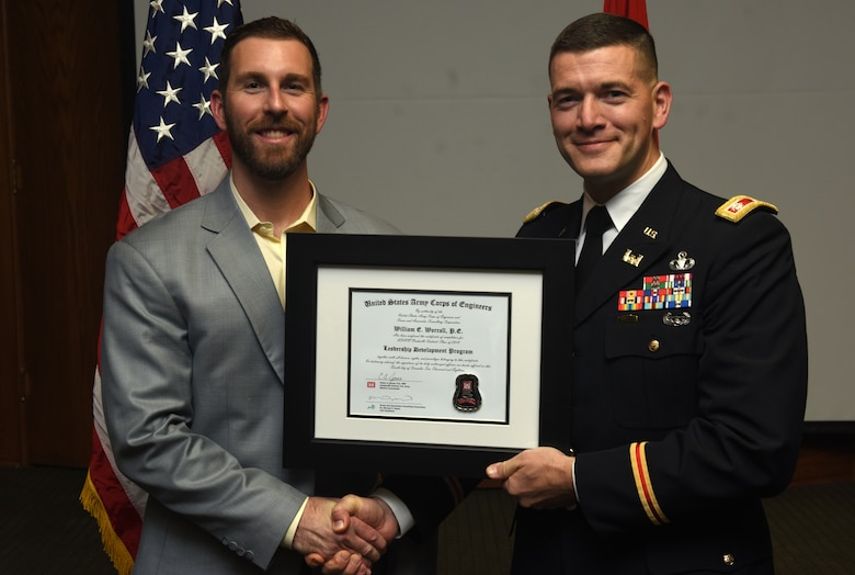 Lt. Col. Cullen Jones, U.S. Army Corps of Engineers Nashville District commander, presents a graduation diploma for the 2018 Leadership Development Program Level II Course to William Worrall during a graduation ceremony Dec. 4, 2018 at the Scarritt Bennett Center in Nashville, Tenn. (USACE Photo by Lee Roberts)