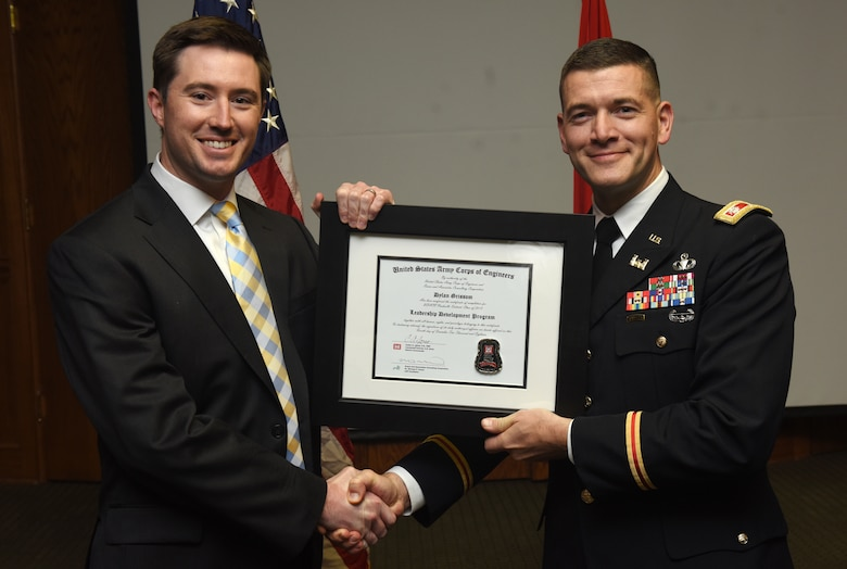 Lt. Col. Cullen Jones, U.S. Army Corps of Engineers Nashville District commander, presents a graduation diploma for the 2018 Leadership Development Program Level II Course to Dylan Grissom during a graduation ceremony Dec. 4, 2018 at the Scarritt Bennett Center in Nashville, Tenn. (USACE Photo by Lee Roberts)