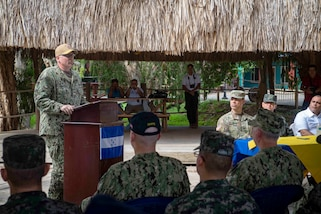 Capt. William Shafley, commanding officer, Task Force 49, delivers remarks during the opening ceremony held at one of two medical sites.