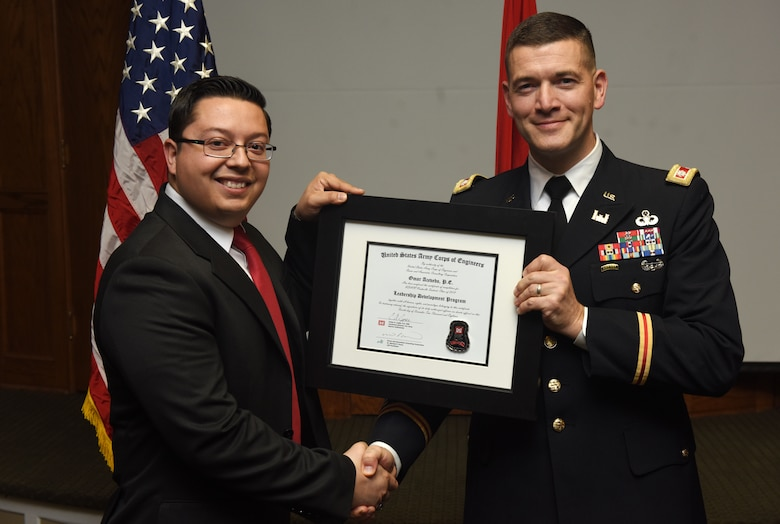 Lt. Col. Cullen Jones, U.S. Army Corps of Engineers Nashville District commander, presents a graduation diploma for the 2018 Leadership Development Program Level II Course to Omar Acevedo during a graduation ceremony Dec. 4, 2018 at the Scarritt Bennett Center in Nashville, Tenn. (USACE Photo by Lee Roberts)