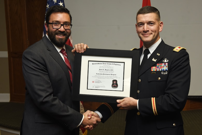 Lt. Col. Cullen Jones, U.S. Army Corps of Engineers Nashville District commander, presents a graduation diploma for the 2018 Leadership Development Program Level II Course to David Bogema during a graduation ceremony Dec. 4, 2018 at the Scarritt Bennett Center in Nashville, Tenn. (USACE Photo by Lee Roberts)