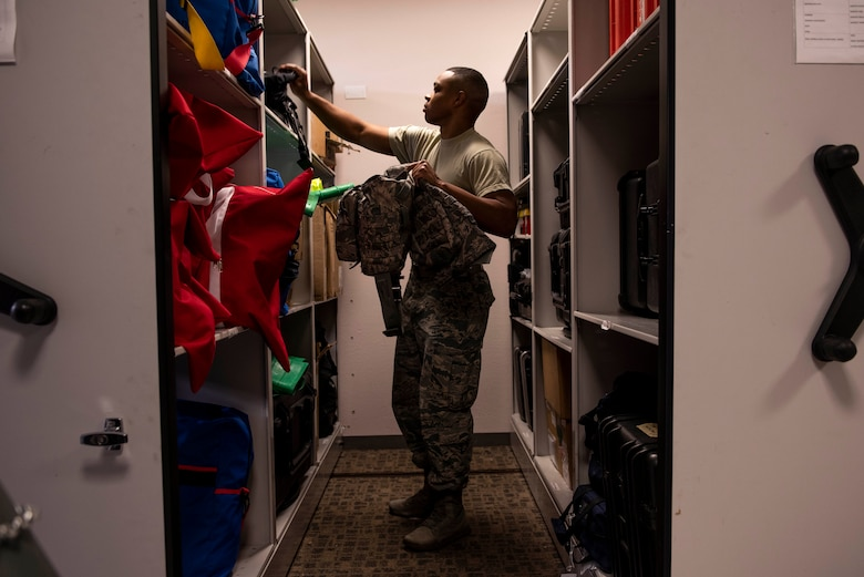 Senior Airman Keyman Hughes, 375th Aerospace Medicine Squadron bioenvironmental engineering technician, retrieves a gas mask from a response shelf in preparation for a training exercise on Nov. 29, 2018, on Scott Air Force Base, Illinois. In order to be response ready, 375th AMDS Airmen train in areas of HAZMAT, chemical, biological, radioactive and nuclear emergency response due to the possibility of being called upon at any moment to asses a potential threat against the base.