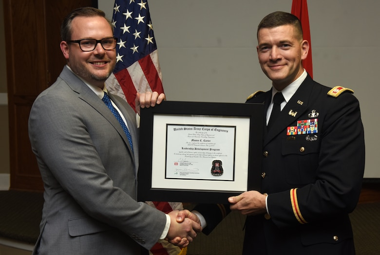 Lt. Col. Cullen Jones, U.S. Army Corps of Engineers Nashville District commander, presents a graduation diploma for the 2018 Leadership Development Program Level II Course to Mason Carter during a graduation ceremony Dec. 4, 2018 at the Scarritt Bennett Center in Nashville, Tenn. (USACE Photo by Lee Roberts)