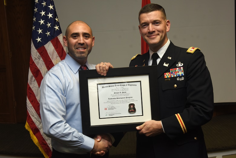 Lt. Col. Cullen Jones, U.S. Army Corps of Engineers Nashville District commander, presents a graduation diploma for the 2018 Leadership Development Program Level II Course to Michael Pardi during a graduation ceremony Dec. 4, 2018 at the Scarritt Bennett Center in Nashville, Tenn. (USACE Photo by Lee Roberts)