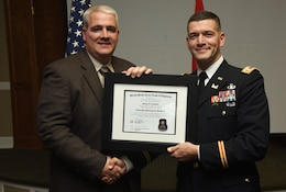 Lt. Col. Cullen Jones, U.S. Army Corps of Engineers Nashville District commander, presents a graduation diploma for the 2018 Leadership Development Program Level II Course to Kenny Claywell during a graduation ceremony Dec. 4, 2018 at the Scarritt Bennett Center in Nashville, Tenn. (USACE Photo by Lee Roberts)