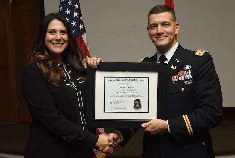 Lt. Col. Cullen Jones, U.S. Army Corps of Engineers Nashville District commander, presents a graduation diploma for the 2018 Leadership Development Program Level II Course to Megan Kentner during a graduation ceremony Dec. 4, 2018 at the Scarritt Bennett Center in Nashville, Tenn. (USACE Photo by Lee Roberts)