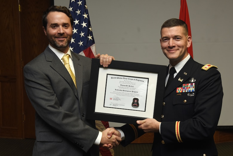 Lt. Col. Cullen Jones, U.S. Army Corps of Engineers Nashville District commander, presents a graduation diploma for the 2018 Leadership Development Program Level II Course to Tom Herbert during a graduation ceremony Dec. 4, 2018 at the Scarritt Bennett Center in Nashville, Tenn. (USACE Photo by Lee Roberts)