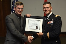 Lt. Col. Cullen Jones, U.S. Army Corps of Engineers Nashville District commander, presents a graduation diploma for the 2018 Leadership Development Program Level II Course to Isaac Taylor during a graduation ceremony Dec. 4, 2018 at the Scarritt Bennett Center in Nashville, Tenn. (USACE Photo by Lee Roberts)