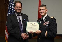 Lt. Col. Cullen Jones, U.S. Army Corps of Engineers Nashville District Commander, presents a certificate of appreciation Dec. 4, 2018 to Course Instructor Michael Evans for his leadership, knowledge, teaching skills, dedication to learning, and commitment to the Nashville District's 2018 Leadership Development Program Level II Course during a graduation ceremony at the Scarritt Bennett Center in Nashville, Tenn. (USACE Photo by Lee Roberts)