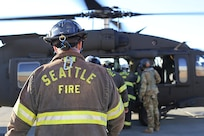 Members of the Seattle Fire Department participated in a training exercise with the Washington Army National Guard aviators doing personnel movement on UH-60 Black Hawk helicopters.