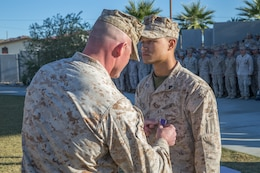 Cpl. Tyler A. Frazier, a mortar Marine with 3rd Battalion, 7th Marine Regiment, is awarded the Purple Heart Medal by Lt. Col. Steven M. Ford, commanding officer, 3/7 at Victory Field aboard the Marine Corps Air Ground Combat Center, Twentynine Palms, Calif., Nov. 7, 2018. Frazier was awarded the Purple Heart for injuries sustained in Syria while 3/7 was deployed with the Special Purpose Marine Air Ground Task Force-Crisis Response-Central Command.