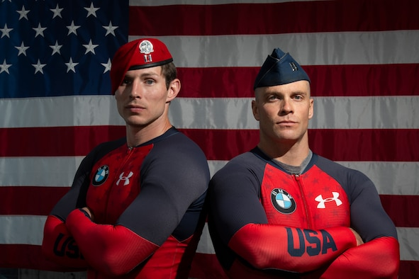 Two people with a flag in the background
