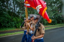 U.S. Marines with the Marine Aircraft Group 24 colorguard march during the 2018 Waimanalo Christmas Parade, Dec. 8, 2018. The parade is held annually and supported by U.S. Marines from Marine Corps Base Hawaii.