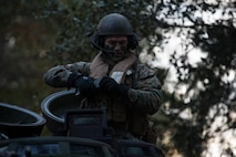 A U.S. Marine with 2nd Assault Amphibian Battalion, 2nd Marine Division, performs a radio check prior to executing river crossing operations during the 6th Marine Regiment field exercise (FEX) aboard Camp Lejeune, N.C., Dec. 7, 2018. The regimental FEX utilizes combat capabilities from across the Marine Air-Ground Task Force, enhancing mission readiness.