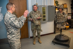 U.S. Army Maj. Gen. Richard Hayes, Jr., right, The Adjutant General for the Illinois National Guard, speaks with Air Force 2nd Lt. Gregory Clampitt, an executive officer with the 182nd Security Forces Squadron, about the unit's equipment configurations during a visit to the 182nd Airlift Wing in Peoria, Ill., Dec. 2, 2018.
