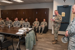 U.S. Army Maj. Gen. Richard Hayes, Jr., second from right, The Adjutant General for the Illinois National Guard, and Air Force Maj. Gen. Ronald Paul, The Assistant Adjutant General - Air for the Illinois National Guard, speak to 182nd Civil Engineer Squadron fire protection specialists during a visit to the 182nd Airlift Wing in Peoria, Ill., Dec. 2, 2018.