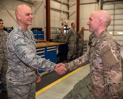 U.S. Air Force Maj. Gen. Ronald Paul, left, The Assistant Adjutant General - Air for the Illinois National Guard, coins Tech. Sgt. Daniel Seymour, an air transportation craftsman with the 182nd Logistics Readiness Squadron, in recognition of his outstanding job performance in Peoria, Ill., Dec. 2, 2018.