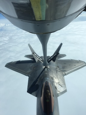 An Air Force Reserve KC-135R Stratotanker crew from the 507th Air Refueling Wing at Tinker Air Force Base, Oklahoma, refuels a U.S. Air Force F-22 Raptor Nov. 5, 2018, from Tyndall Air Force Base, Florida, while en route to Hill Air Force Base, Utah.