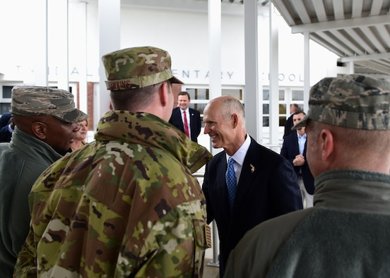 Gov. Rick Scott, current governor of Florida, greets 325th Fighter Wing leadership during a visit to the re-opening of Tyndall Elementary School near Tyndall Air Force Base, Fla., Dec. 10, 2018. Scott visited the area numerous times in the wake of Hurricane Michael. (U.S. Air Force photo by Senior Airman Isaiah J. Soliz