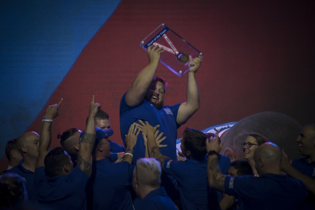 "Rob Hufford, Department of Defense Warrior Games athlete and Team Air Force member, is lifted up by his teammates after being awarded the ""heart of the team"" award for Team Air Force durinh the Games closing ceremony at the U.S. Air Force Academy, Colorado Springs, Colorado, June 9, 2018. To determine the recipients of the heart of the team award, athletes representing each service team voted for the member of their team who they believe embodies the heart of their team. (U.S. Air Force Photo by Senior Airman Dennis Hoffman)"