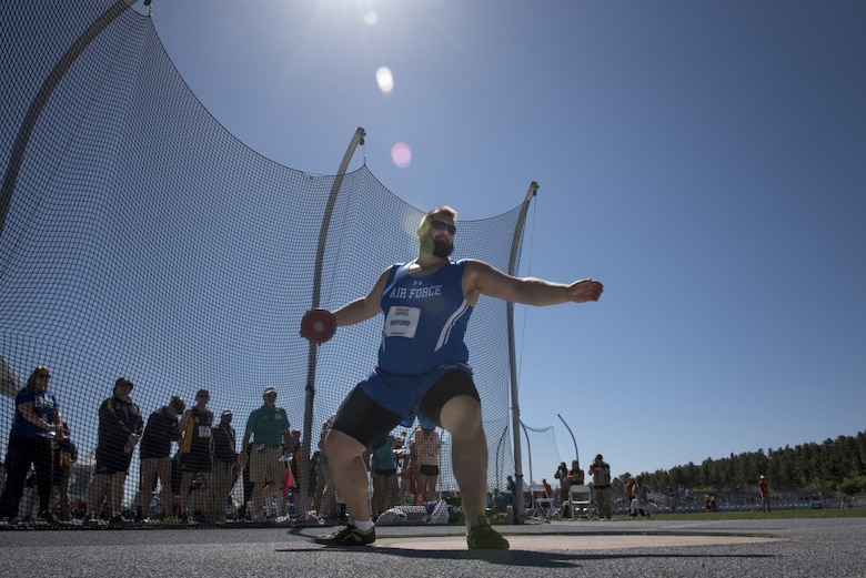 Rob Hufford II, Department of Defense Warrior Games athlete on Team Air Force, competes in the men's standing discuss event at The Games in Colorado Springs, Colorado, June 1, 2018. The Warrior Games will be held at the U.S. Air Force Academy June 1- 9, 2018. (U.S. Air Force Photo by Senior Airman Dennis Hoffman)