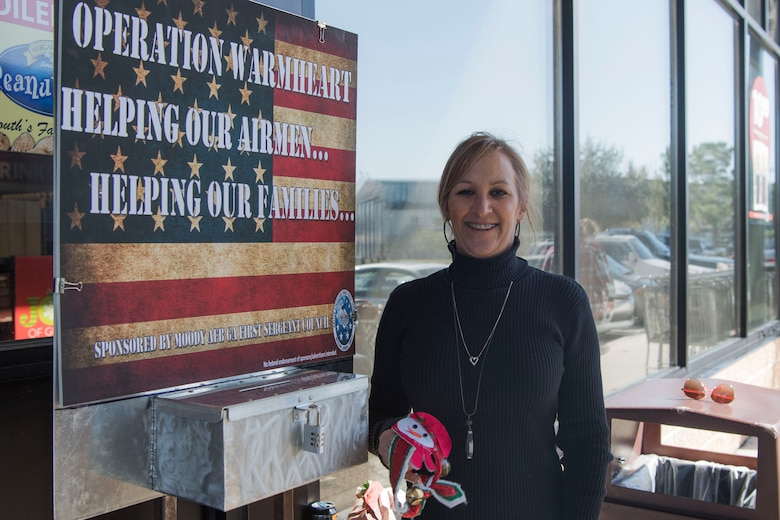 Kelly Denson, 71st Rescue Squadron unit program coordinator, poses for a photo during Ring the Bell, Dec. 4, 2018, at Moody Air Force Base, Ga. Operation Warmheart is a private organization ran by the first sergeants of Moody. The Ring the Bell event is the only fundraiser the first sergeants do to support Operation Warmheart, which allows first sergeants of Moody to give out thousands of dollars in gift cards to Airmen in need. (U.S. Air Force photo by Airman Taryn Butler)