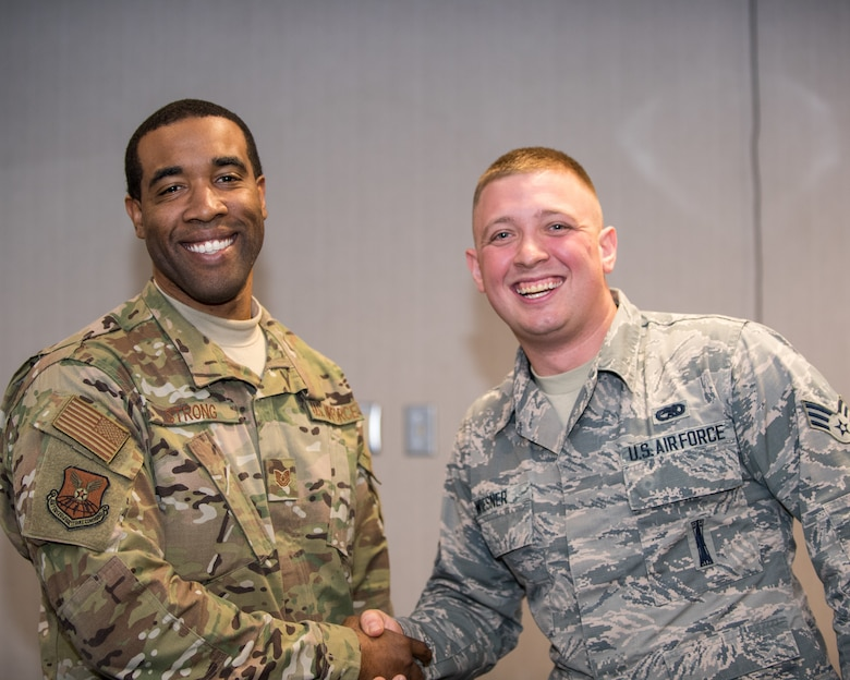 Tech. Sgt. LaRon Strong, 2nd the 2nd Operations Support Squadron aircraft support section chief, and Senior Airman Spencer Wiesner, 2nd Munitions Squadron line delivery chief, pose for a photo after the Diamond Sharp Award (DSA) ceremony at Barksdale Air Force Base, La., Nov. 21, 2018. Wiesner won the DSA for the month of November. (U.S. Air Force photo by Airman 1st Class Lillian Miller)