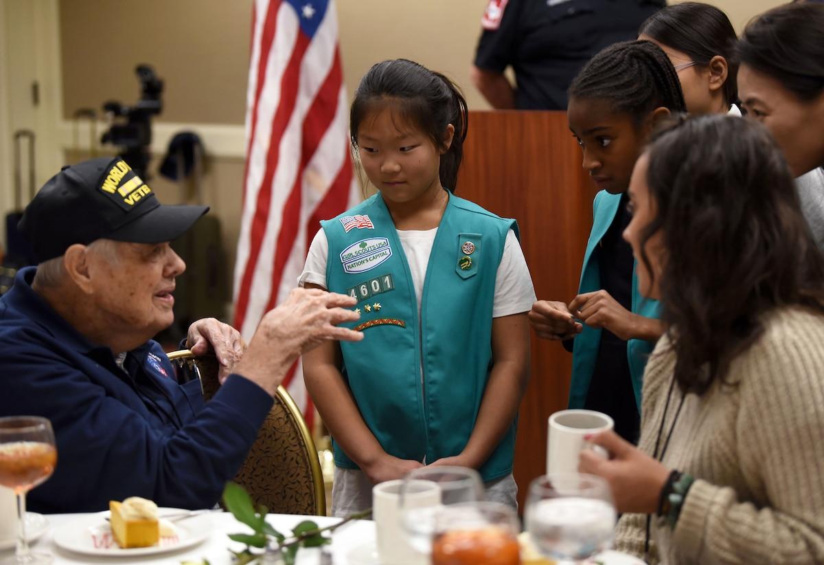 A veteran talks with girls.