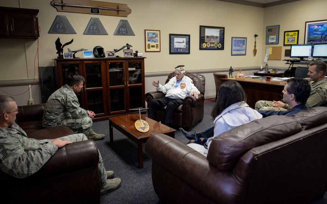 Ed Hall, Pearl Harbor Survivor, recalls his Pearl Harbor attacks experience with 99th Air Base Wing leadership Dec. 7, 2018 at Nellis Air Force Base, Nevada. Hall spent National Pearl Harbor Remembrance Day touring Nellis and visiting Airmen. (U.S. Air Force photo by Airman 1st Class Bailee A. Darbasie)