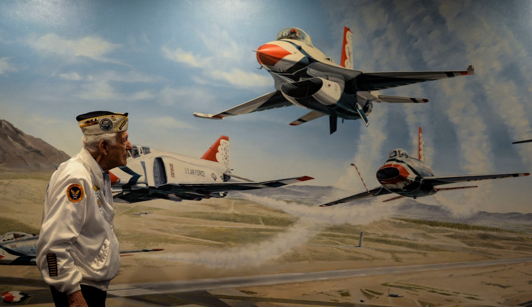 Ed Hall, Pearl Harbor Survivor, observes a mural of the Thunderbirds Dec. 7, 2018 in the Thunderbird Museum at Nellis Air Force Base, Nevada. Hall tested a superstition that stated if he walked from one side of the mural to the other, the jets would appear to fly towards him. (U.S. Air Force photo by Airman 1st Class Bailee A. Darbasie)