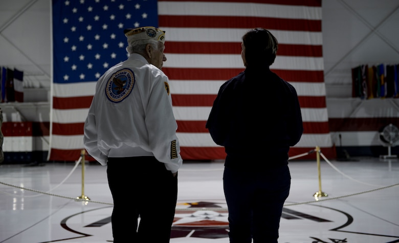 Ed Hall, Pearl Harbor Survivor, speaks with Master Sgt. Christine Powers, Public Affairs superintendent for the Thunderbirds, Dec. 7, 2018 in the Thunderbirds Hangar at Nellis Air Force Base, Nevada. Hall toured the Thunderbirds Museum and explored the hangar. (U.S. Air Force photo by Airman 1st Class Bailee A. Darbasie)