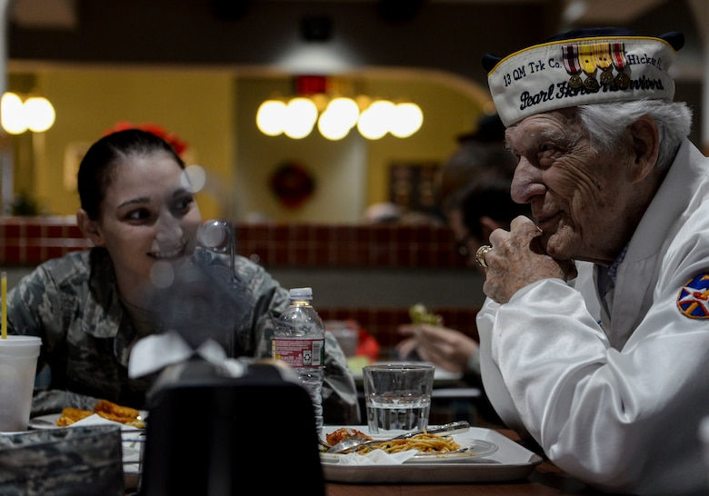 Ed Hall, Pearl Harbor Survivor, has lunch with Airmen Dec. 7, 2018 in the Crosswinds Dining Facility at Nellis Air Force Base, Nevada. Airmen assigned to various squadrons flocked to Hall to thank him for his service. (U.S. Air Force photo by Airman 1st Class Bailee A. Darbasie)