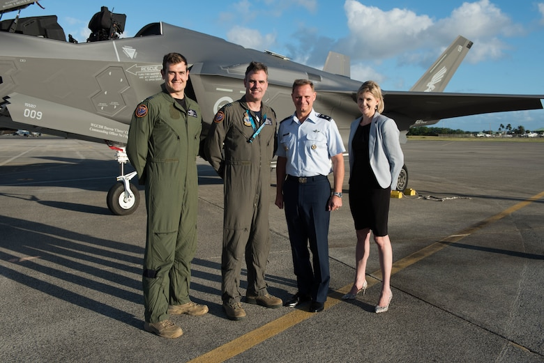 Royal Australian Air Force Flight Lieutenant Ben Monaghan, RAAF Wing Commander Darren Clare, No. 3 Squadron commander, U.S. Air Force Maj. Gen. Russ Mack, Pacific Air Forces deputy commander, and Sally Timbs, Australian Consul, Defense Policy, pose for a photo in front of a RAAF F-35A at Joint Base Pearl Harbor-Hickam, Hawaii, Dec. 3, 3018.