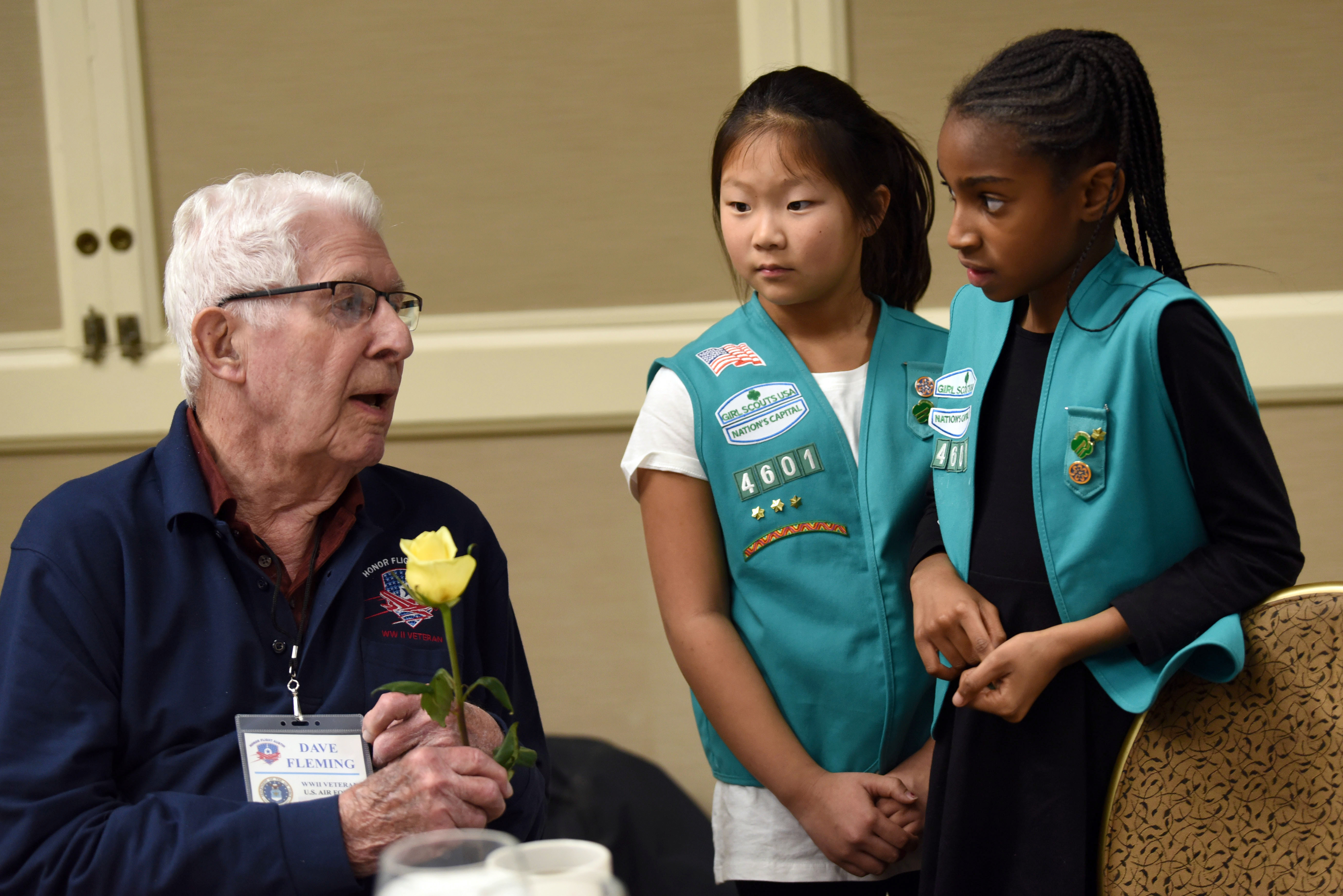 veteran talking with girl scouts