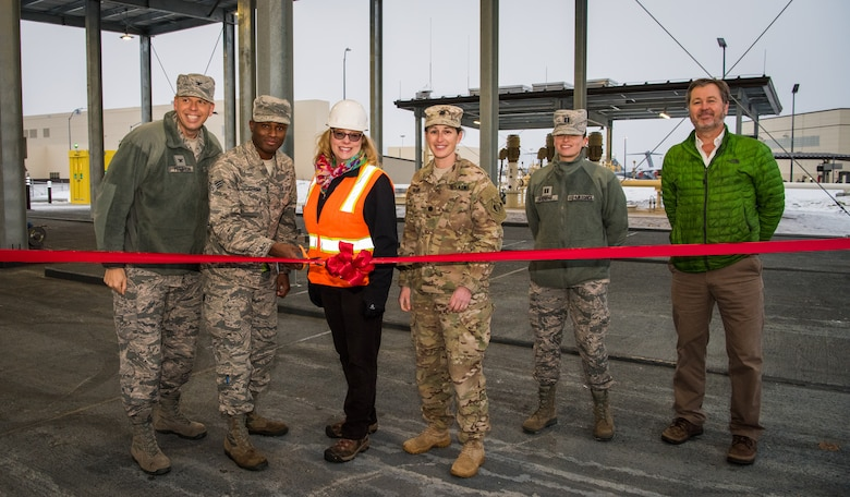 Arctic warriors pose for a photo at a ribbon-cutting ceremony at Joint Base Elmendorf-Richardson, Alaska, Dec.6, 2018. The ceremony served as the unveiling of a new state-of-the-art fuel offloading facility called a JP-8 Alternate Offload Header, providing JBER a new alternate fuel receipt capability