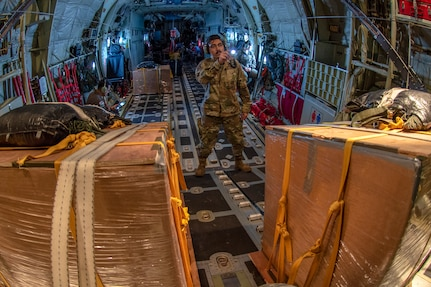 Nicolas Ortiz, 374th Aircraft Maintenance Squadron flying crew chief out of Yokota Air Base, Japan, completes an in-flight check on the systems of Santa 21, a U.S. Air Force C-130J Super Hercules on its way to deliver critical supplies to the island of Nama, Federated States of Micronesia (FSM) during Operation Christmas Drop 2018, Dec. 10, 2018. Every December crews from Yokota team up with the Japan Air Self-Defense Force (Koku Jietai), and Royal Australian Air Force to airdrop supplies to the Commonwealth of the Northern Marianas, FSM, and the Republic of Palau.