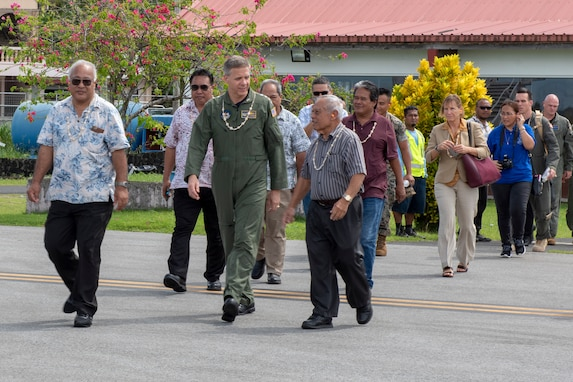 Commander, U.S. Indo-Pacific Command, Adm. Phil Davidson walks with local leaders of the Federated States of Micronesia (FSM) prior to boarding a U.S. Air Force C-130J Super Hercules during Operation Christmas Drop 2018 on the island of Chuuk, FSM, Dec. 10, 2018. The visit allowed Davidson the opportunity to not only take in the OCD mission firsthand, but also share that experience with the local community.