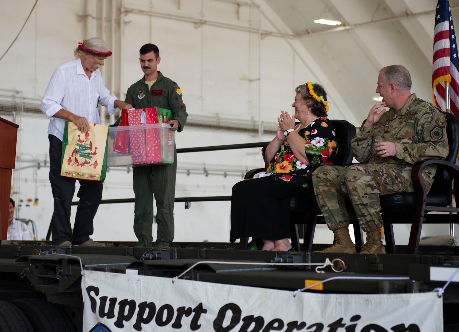 Bruce Best, researcher, University of Guam, far left, prepares to hand cultural gifts to the official party during the Operation Christmas Drop Push Ceremony at Andersen Air Force Base Dec. 10.  During the ceremony, the first of nearly 100 boxes of humanitarian goods was pushed into a C-130 before being delivered to 56 islands across the Commonwealth of the Northern Mariana Islands, the Federated States of Micronesia and the Republic of Palau.