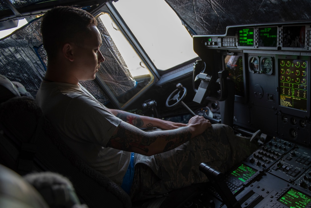 Staff Sgt. Matthew Haston, 374th Aircraft Maintenance Squadron electrical and environmental systems craftsman, goes over the C-130J Super Hercules' instruments during a pre-flight inspection during Operation Christmas Drop 2018 at Andersen Air Force Base, Guam, Dec. 9, 2018.