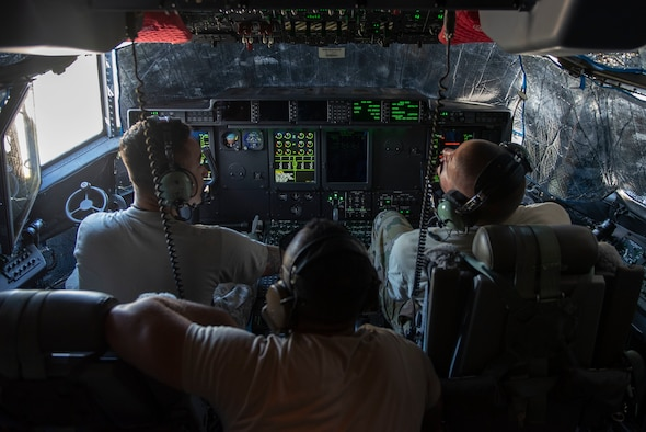 Airmen from the 374th Aircraft Maintenance Squadron monitor the instrument readings while communicating with the flying crew chief via radio during an aircraft refueling process at Operation Christmas Drop 2018 at Andersen Air Force Base, Guam, Dec. 9, 2018.