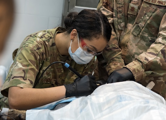 U.S. Air Force Staff Sgt. Torri Olievieri, 386th Expeditionary Medical Group dental services non-commissioned officer in charge, conducts a teeth cleaning at an Undisclosed Location in Southwest Asia, Dec. 7, 2018. While deployed, the veterinary clinic relies on the medical group for many of their medications and to be a contingency plan if they an emergent situation were to occur.