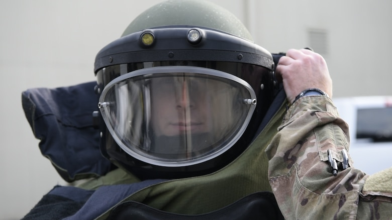 Senior Airman Jacob Gerow, 436th Civil Engineer Squadron, explosive ordnance disposal (EOD) journeyman, dons his bomb suit for his part in EOD's improvised explosive device exercise during Prime Base Engineer Emergency Force (Prime BEEF) Day Nov. 28, 2018, at Dover Air Force Base, Del. Prime BEEF Day is a squadron-wide training day focused on maintaining and refreshing all civil engineering Airmen on readiness requirements and operational capabilities. (U.S. Photo by Airman First Class Dedan D. Dials)
