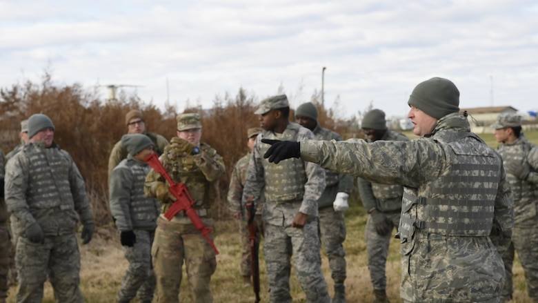 Tech. Sgt. Casey Reed, 436th Civil Engineer Squadron unit deployment manager, directs a group of Airmen for the Individual Movement Techniques portion of Prime Base Engineer Emergency Force (Prime BEEF) Day on Nov. 28, 2018, at Dover Air Force Base, Del. Prime BEEF Day is a squadron-wide training day focused on maintaining and refreshing all civil engineering Airmen on readiness requirements and operational capabilities. (U.S. Photo by Airman First Class Dedan D. Dials)